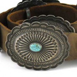Typical Navajo stamped concho with single turquoise setting