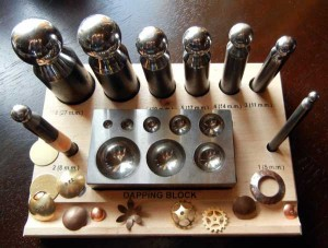 This is an example of a metal dapping set, wood is also used.
