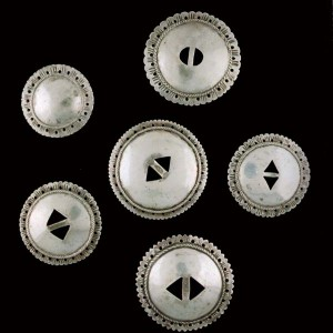 This is a group of First Phase Navajo Conchas collected by the Smithsonian Museum. Please notice the enclosed domed concha at the upper left. This is a very rare specimen for this period.